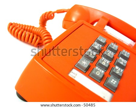 Vintage orange telephone. Focus on buttons. - stock photo