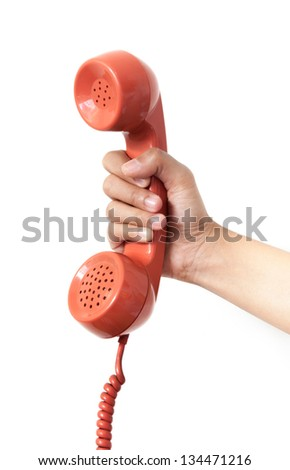 vintage orange telephone handset over white background
