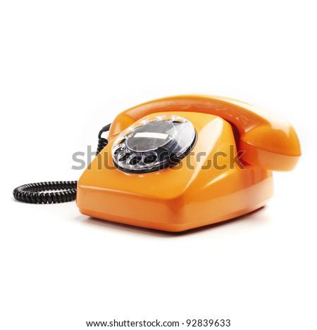 vintage orange telephone isolated over white background - stock photo