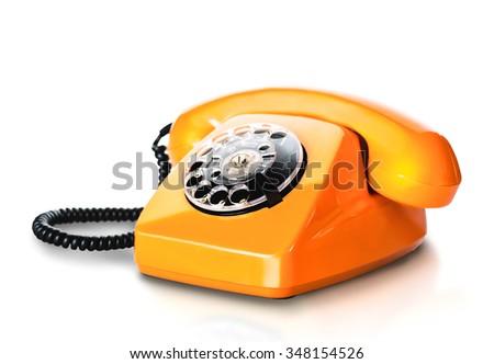 Vintage orange telephone on white - stock photo
