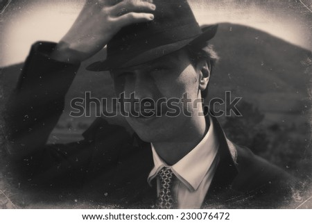 Vintage outdoor photo of a gentleman taking his hat off. Black and white retro styled imagery - stock photo