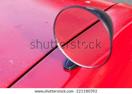 Vintage outside rear mirror of an old-timer.  - stock photo