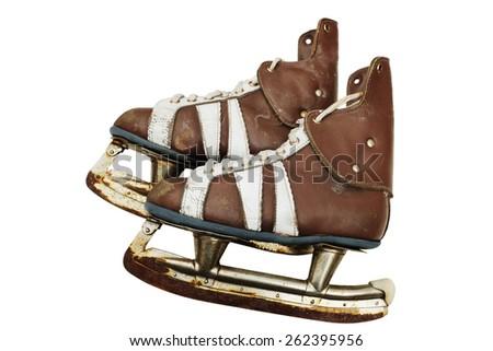 vintage pair of mens  ice skates on white background - stock photo