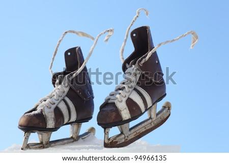 vintage pair of mens  skates on the ice - stock photo