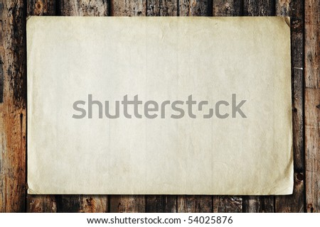 vintage paper on old wood texture - stock photo