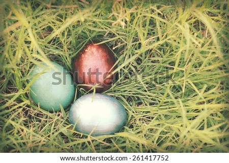 Vintage paper textures, Colorful easter eggs hidden in dense grasses. Spring holidays concept. - stock photo