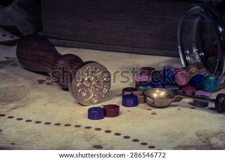 Vintage parchment with wax seal - stock photo