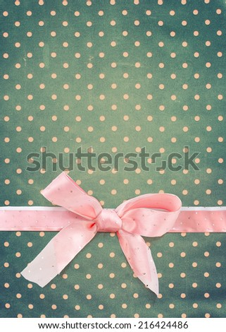 Vintage Pattern with Polka Dots and Pink Ribbon on Grey Fabric, old vintage style - stock photo