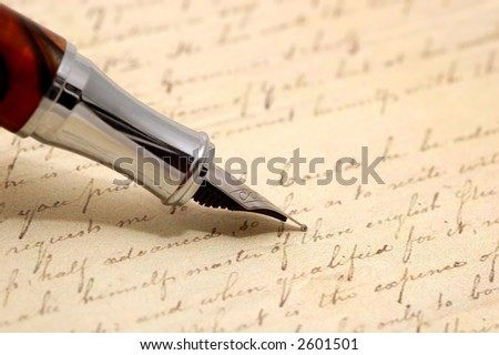 vintage pen and old letter in background - stock photo