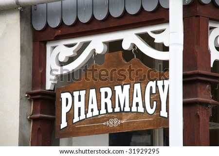 Vintage PHARMACY sign in historic town of Arrowtown, New Zealand. - stock photo