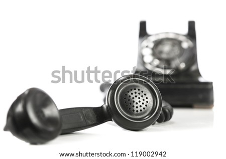 Vintage phone and receiver on white - stock photo