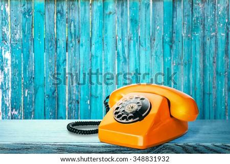 Vintage phone on table - stock photo