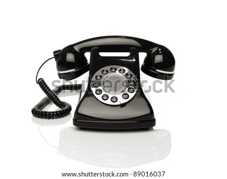Vintage phone on white background - stock photo