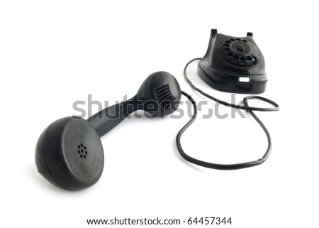 Vintage phone with taken off receiver taken with fish-eye lens. - stock photo