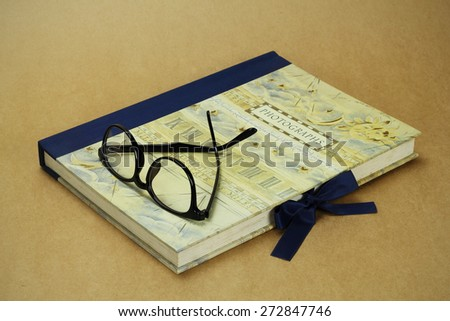 Vintage photo album on a brown paper background - stock photo