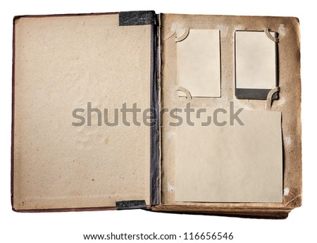 vintage photo album with grunge pages - stock photo