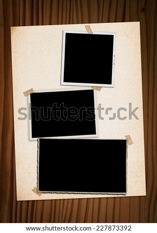 Vintage photo album with three old photographs. - stock photo
