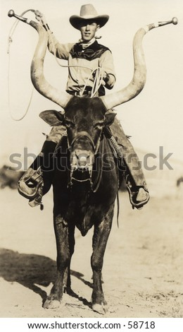 Vintage photo, circa 1900, of a cowboy riding a longhorn steer - stock photo