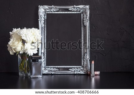 Vintage photo frame and flowers on a black textured background. Place for your text