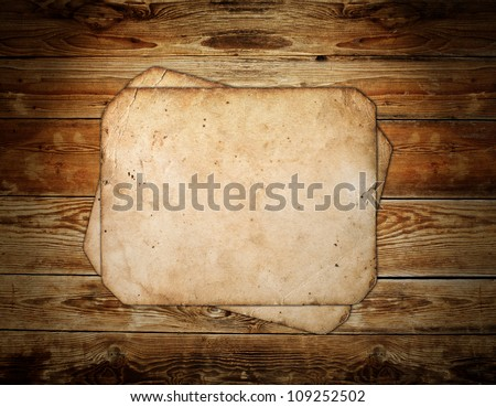 Vintage photo frame on wood background - stock photo