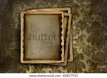 Vintage photo frames on grungy floral background - stock photo