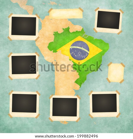 Vintage photo frames on the background with the vintage map of Brazil. On the map is Brazilian flag painted in the country borders. - stock photo
