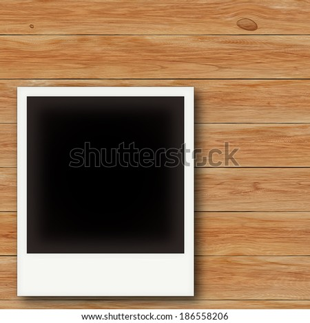 Vintage photo frames on wooden board - stock photo