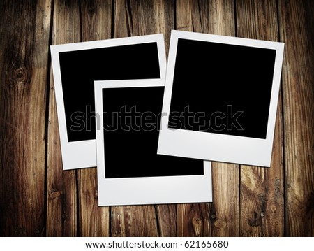 vintage photo frames over grunge wood background
