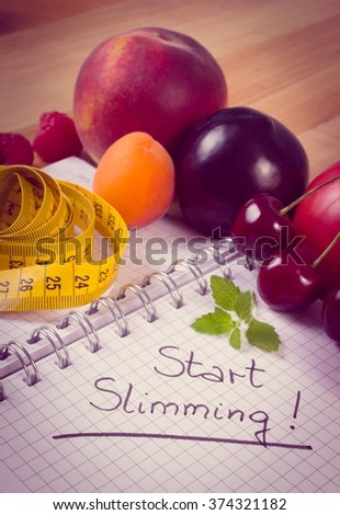 Vintage photo, Fresh fruits and vegetables with tape measure and notebook for writing notes, concept of slimming, diet and healthy nutrition - stock photo