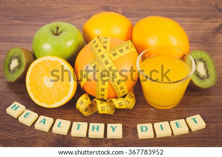 Vintage photo, Fresh ripe fruits, glass of juice and tape measure on wooden surface plank, grapefruit orange kiwi apple, healthy lifestyles diet and strengthening immunity - stock photo