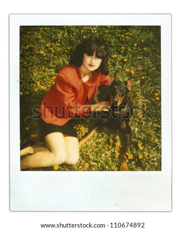 vintage photo girl with a dog Doberman (made to look old) - stock photo