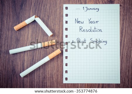 Vintage photo, New years resolutions quit smoking written on sheet of paper and broken cigarette, concept of healthy lifestyle, world no tobacco day - stock photo