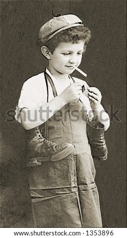 Vintage photo of a Boy Lighting a Cigarette - stock photo