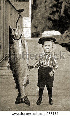 Vintage photo of a Boy Posing Next To Really Big Fish - stock photo