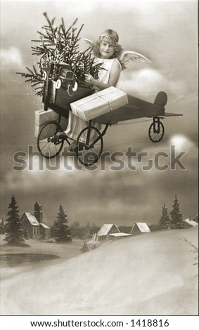 Vintage photo of a Floating Christmas Angel With Presents - stock photo