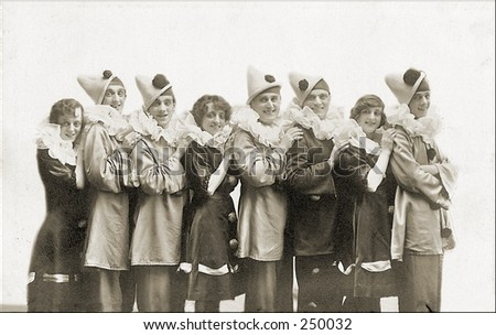 Vintage Photo of a Group of People In Clown Outfits - stock photo