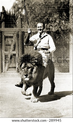 Vintage photo of a Lion Tamer Rides Lion In Show - stock photo
