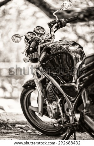 Vintage photo of a parked beside the road bike.Vintage sepia  effect added for create atmosphere - stock photo