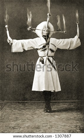 Vintage photo of a Russian Performer Doing Flaming Balancing Act - stock photo
