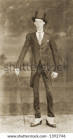 Vintage photo of a Thin Man In Dark Suit - stock photo