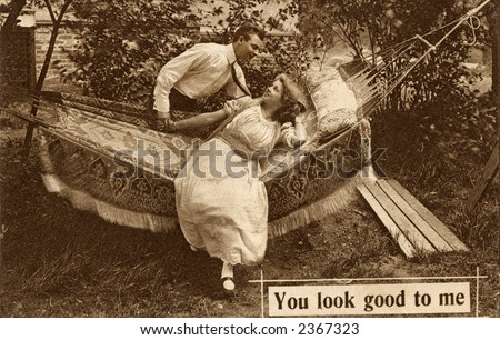 Vintage photo of a young couple in a hammock - stock photo