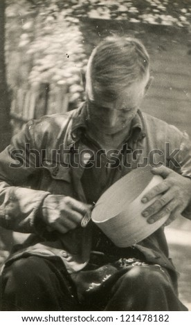 Vintage photo of artisan making a wooden sifter (sixties)