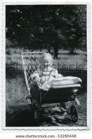 Vintage photo of baby (1955) - stock photo