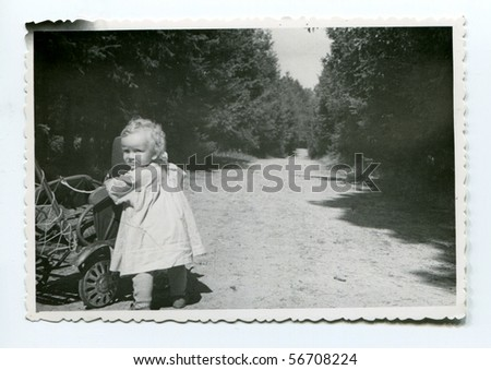 Vintage photo of baby girl (fifties) - stock photo