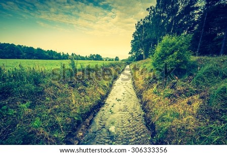 Vintage photo of beautiful landscape with morning meadow. Sunrise over morning meadow in Poland - stock photo
