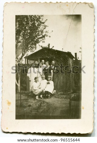 Vintage photo of big family (thirties) - stock photo