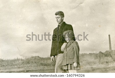 Vintage photo of brother and little sister - fifties - stock photo