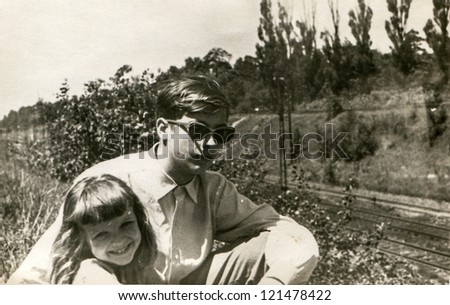 Vintage photo of brother with younger sister (fifties) - stock photo