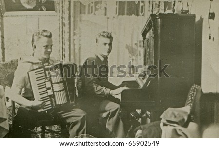 Vintage photo of brothers playing music (forties)