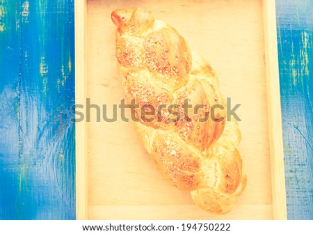 vintage photo of challah on the table - stock photo